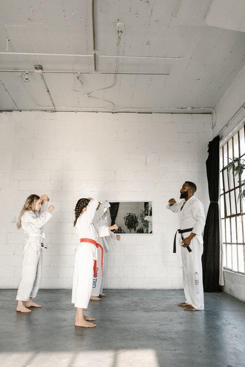 Martial Arts School   Karate Coach Instructing